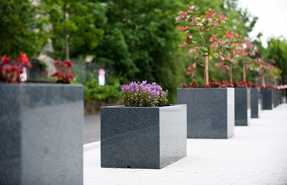 close up look of mix custom granite planters in derry park